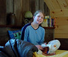 Danièle, 13 years old, in her loft corner of the cabin<br /> December 18, 2002