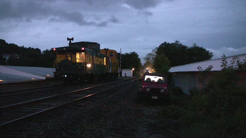 Night approach of Motorcycle Week Shuttle Train past caboose