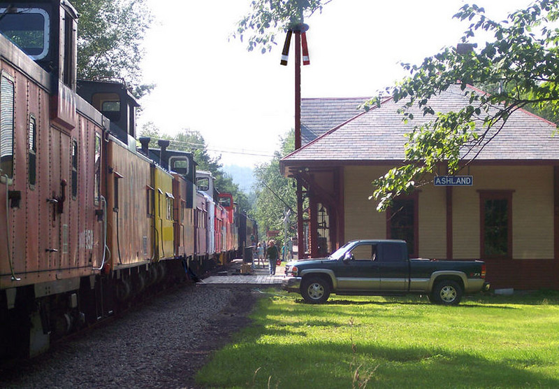 <strong>One Beautiful Station:</strong>  Ashland Station in Ashland, NH a real gem! Here the caboose train passes on a warm summers day. Photo G Kenson