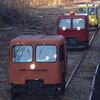 <strong>Motorcars Passing The Caboose Train:</strong>  Passing the caboose train are the Motorcars that visit the Hobo RR twice a year. Photo by G Kenson