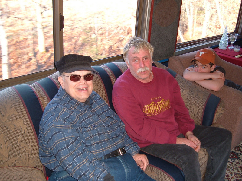 A Couple Of Hobos On The HOBO: Hobos Ben & Gary talk shop on Gary's Private Car which is part of the caboose train consist traveling along the HOBO RR on Dec 3rd 2006 between Lincoln & Tilton,NH