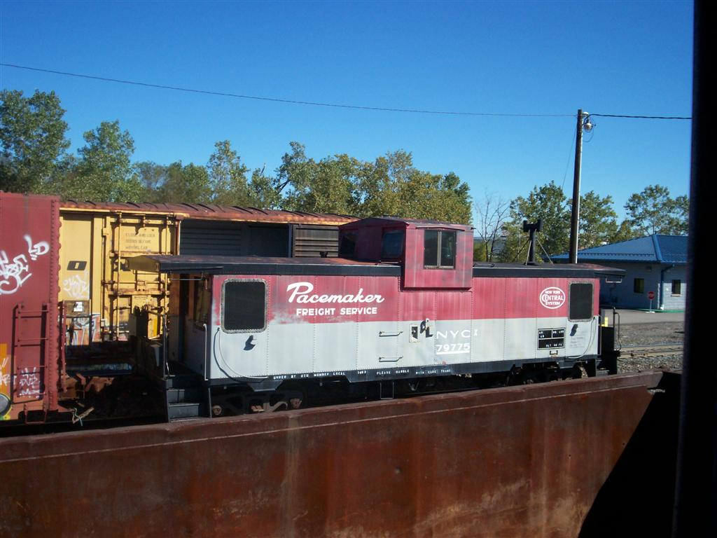 """Spotted in Buffalo: The caboose arrived mid-day on Saturday, October 7 in Buffalo, NY. Many thanks to Brenda Potter Reynolds for sending us this photo of our caboose on the loose!  <strong>See more in: <A HREF=""""/Caboose-Trains-and-Our-Caboose/Rutland-51-Our-Caboose/Moving-the-Caboose/8472815_gaxUM"""">Moving the Caboose</A></strong>"""