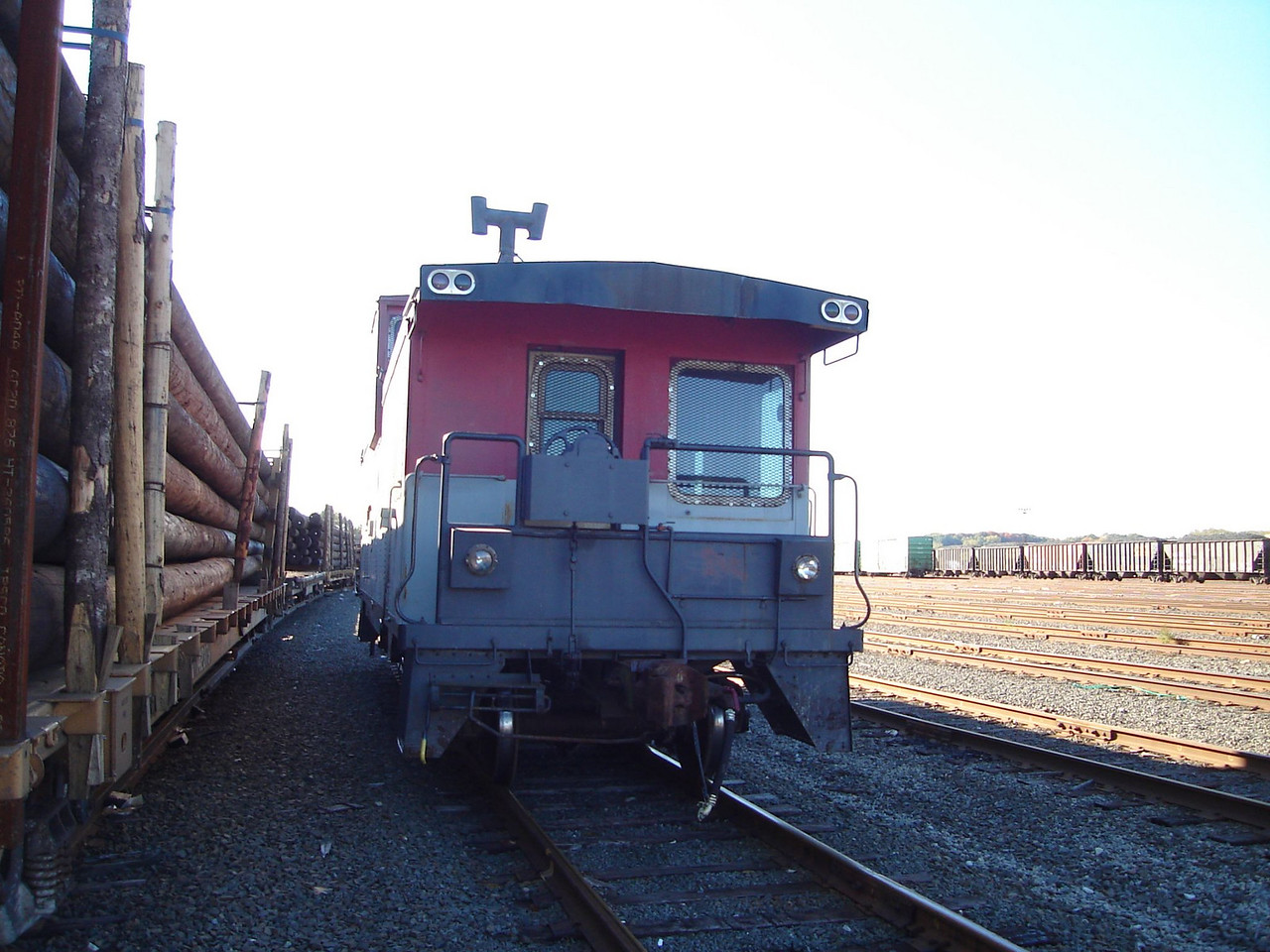 "Caboose Next to Log Cars: In Springfield, MA. Waiting to be accepted by Guilford to complete its trip to New Hampshire. Thanks fo Paul Hayhurst for taking and sending the picture.  <strong>See more in: <A HREF=""/Caboose-Trains-and-Our-Caboose/Rutland-51-Our-Caboose/Moving-the-Caboose/8472815_gaxUM"">Moving the Caboose</A></strong>"