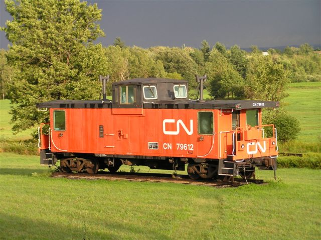 Sister Caboose In Upstate NY: Sister Caboose to the NYC 79775 is CN 79612. This is what the buggy looked like before it was painted NYC colors. These were the factory colors on the CN caboose. Picture taken by Ian MacKeller owner of this caboose in his backyard in Upstate New York, and former owner of my caboose.