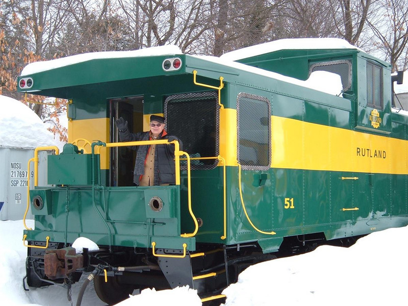 Hobo On Rutland 51: Long time railroader inspects the newly painted caboose and gives it his seal of approval.