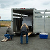 Team effort, might not be mandatory, but is added security in moving the equipment off the trailer.