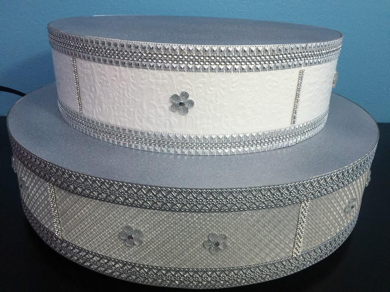 "24"" Diameter Two Tier Silver Bling with Ledge 10"" tall. Rental $50"