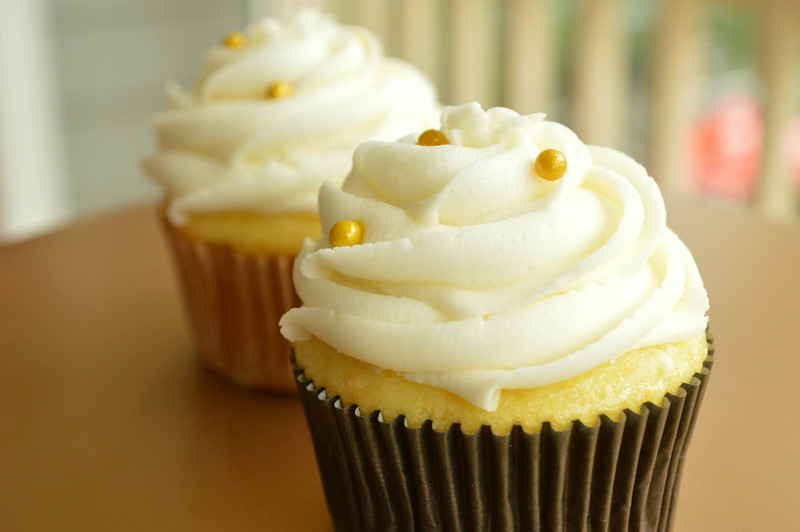 Classic buttercream cupcakes with gold edible pearls!