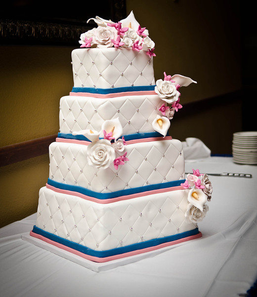 Simple 4-tier cake. Flowers were hand made to match the bride's bouquet, consisting of pink hydrangea, white roses and calla lillies.