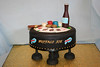 Poker table cake for a 50th birthday.  Yellow cake with chocolate cream cheese filling.  Covered in black fondant and greed top.  Poker chips and beer bottle are made of chocolate, playing cards are made of gumpaste with edible transfers.  Cigar is modeing chocolate and fondant.  Feeds 40 $250.00