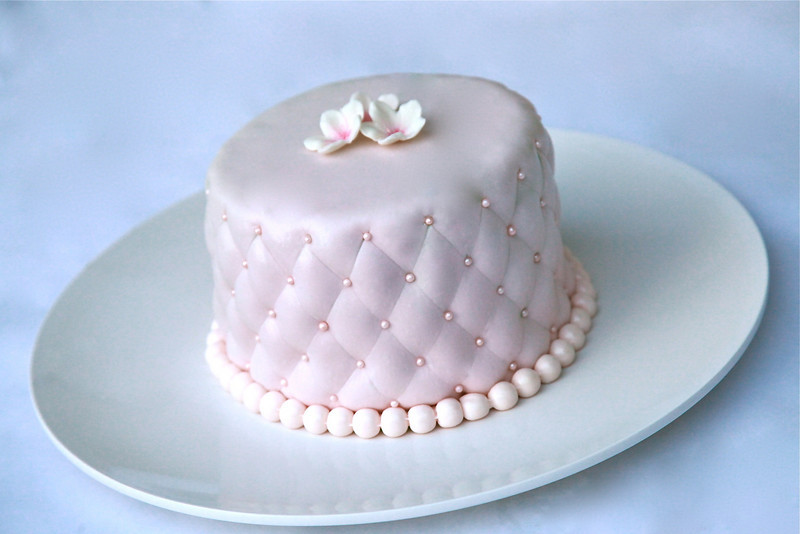 "Fondant ""quilted"" cake, with fondant flowers and pearls. 100% edible."