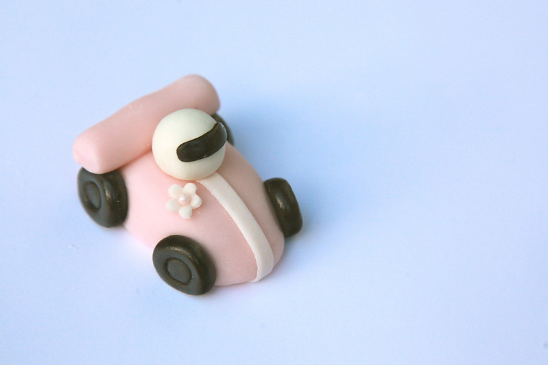 Pink car cupcake topper - all the wheels are chocolate fondant. All fondant, icing, cakes, and cupcakes are made from scratch, no additives or preservatives.