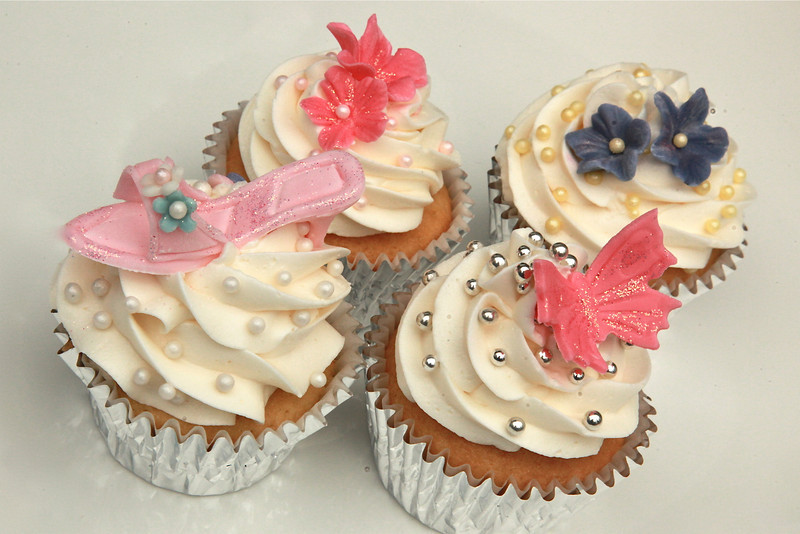 Fondant glitter high heeled show, butterfly, and flower cupcakes