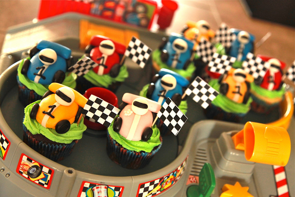 Damian's 1st birthday party cupcakes - chocolate and vanilla cupcakes made from scratch with all those car toppers in the previous pictures. The pink car was specially made for mom, but I should have made more as the little girls at the party were a little jealous of mom's special pink car! :)