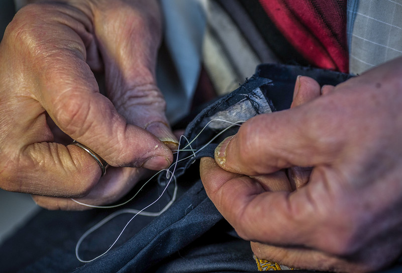 November 12, 2016. Dino's fingers are worn and have calluses from sewing needles for much of his shift at work. <br /> Dino Sicicchia (cq), 72, an immigrant from Italy, owns a tailor shop on Monroe Ave. in Rochester, N.Y. that he has worked in for 18 years. Dino makes all of the income between he and his wife. Dino works in his shop six days a week from 8 a.m. to 6 p.m. Dino is considered a hero to his wife for the long hours and many days he works to provide the necessary income for his family.