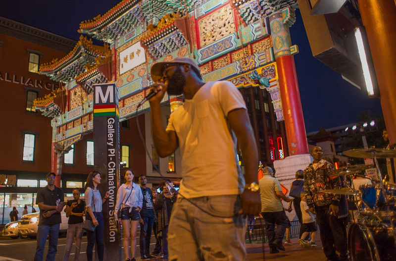 9/29/17 - Chinatown, Washington D.C. - Rapper Kenny Sway sings outside of the Verizon Center before a Washington Capitols hockey game.