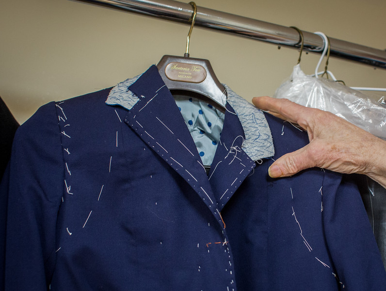 November 12, 2016. Dino works on all varieties of clothing: pants, hats, shoes, jackets and shirts. This is a woman's coat that he has yet to finish. <br /> Dino Sicicchia (cq), 72, an immigrant from Italy, owns a tailor shop on Monroe Ave. in Rochester, N.Y. that he has worked in for 18 years. Dino makes all of the income between he and his wife. Dino works in his shop six days a week from 8 a.m. to 6 p.m. Dino is considered a hero to his wife for the long hours and many days he works to provide the necessary income for his family.