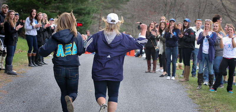 "Saturday, April 25, 2015. Bystanders cheer on runners participating in Alpha Xi Delta's first ever ""Light It Up Blue 5k,"" at Blue Spruce Trail. All proceeds benefited Autism Speaks. (Cal Cary/The Penn)"