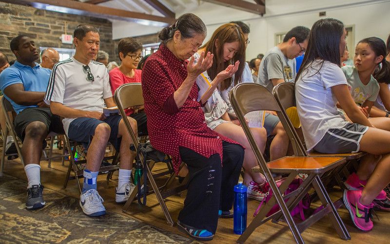 7/16/17- Loin Ho Shin prays during the Chinese Community Church service.  e Church puts the event together annually at Mead- owbrook Park, Md.