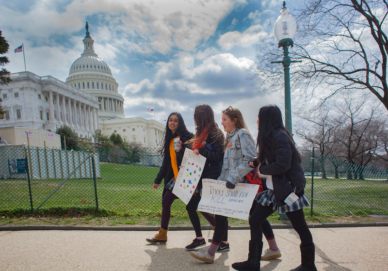 Washington, D.C. : 3/14/18  <br /> Students carrying signs leave the Capitol grounds after a day long protest where they hoped to sway senators to enact stricter gun laws.