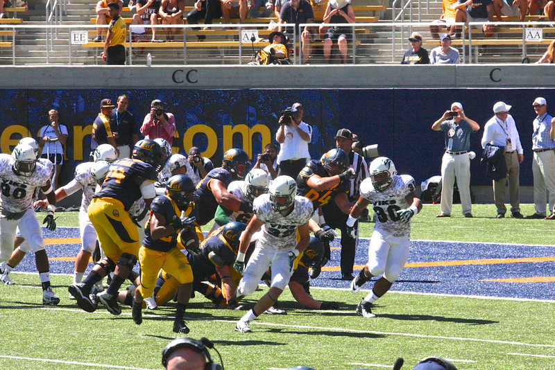 Khalfani Muhammad takes the handoff from Goff and sprints to the right