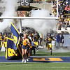 The players are led on to the field by Cal Spirit