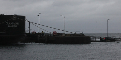 Stern of MV Clansman at Brodick Pier with last car coming off onto flooded linkspan. 3 January 2014