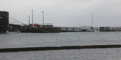 CalMac van coming off MV Clansman at Brodick Pier onto flooded linkspan. 3 January 2014