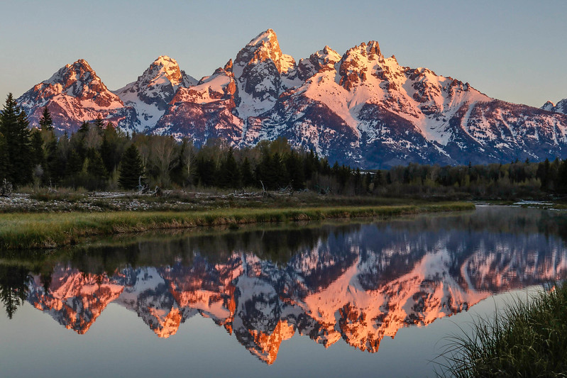 The Dawn Breaks Like Glass over the Tetons