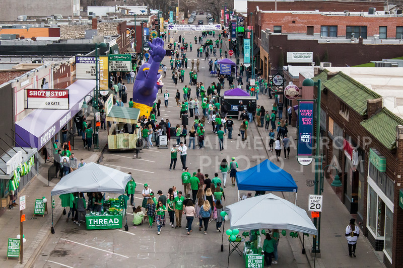 Citizens from Manhattan and surrounding areas come to Aggieville to celebrate Fake Patty's Day with their family and friends. With games, food, and music, there are plenty of things to keep people coming. (Logan Wassall | Collegian Media Group)