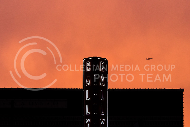 A plane is seen flying in the sunset of the Fake Patty's celebrations in Aggieville. (Alex Todd | Collegian Media Group)