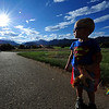 Photo by Walt Hester<br /> A young boy takes a super-heroic pose in Estes Park's Stanley Playground. His mother later explained the boy refused to take off his cape.