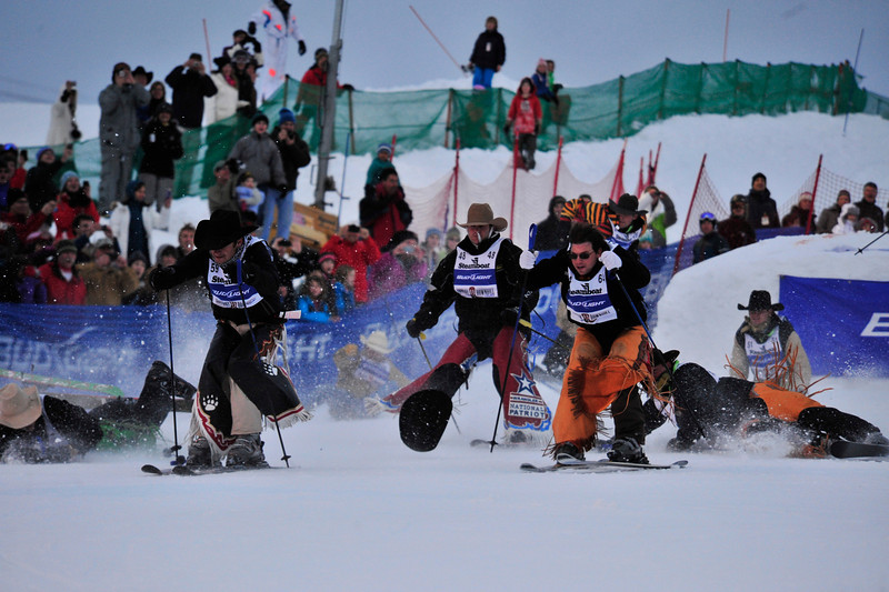Photo by Walt Hester<br /> Real cowboys ski, slide and stumble down the slope at the Cowboy Downhill in Steamboat Springs. The event began when Olympic skier Billy Kidd invited cowboys from the Western Stock Show to the resort town for a little winter fun.