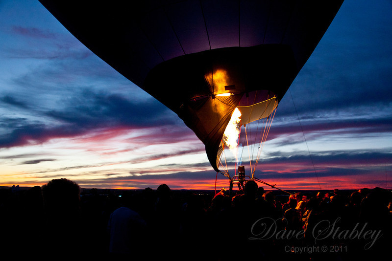 The Glow - As the sun sets, with their balloons tethered to the ground, the pilots fire up their burners and illuminate the envelopes against the darkening sky.  Spectacular!!