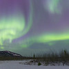 January: A view of the Northern Lights as seen from Whitehorse, Yukon, in Canada. This image is a several second exposure of the aurora taken in the freezing cold around midnight.