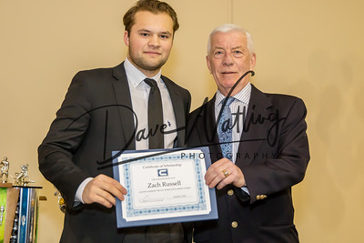 Zach Russel receives the Old Timers Scholarship of Merit