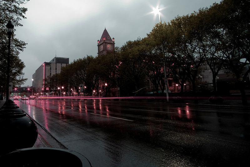 Looking across Macleod Trail at  City Hall and the main library (partially desaturated)