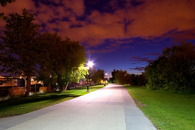 Path along the south side of the Bow river. The 15 second exposure caused the pink-colored clouds to really stand out.
