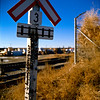 "Alyth Yards, Calgary Alberta<br /> Bronica SQ-A, 80mm<br /> Fujichrome Pro 50 <br /> <br /> The ""tacks"" in the crossing sign are flares that have burnt out"
