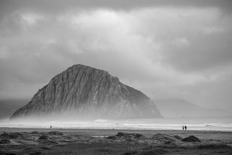 Colorless Morro Rock Surrounded by Clouds