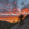 Layers of Colorful Clouds Above a Granite Landscape