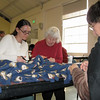 Heather Logan, l-r, Norma Fredrickson, and Teresa Mierzejewski work on a blanket for the Linus Project.