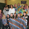 A group of women and girls from Bethlehem Lutheran Church, North Hollywood, show off their handiwork at the Linus Project event held at their church Feb. 6.