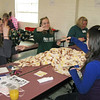 Jamie Semel, l-r, Alyssa Hitchcock, and Vicky Stark use their own sign language while working on blankets.