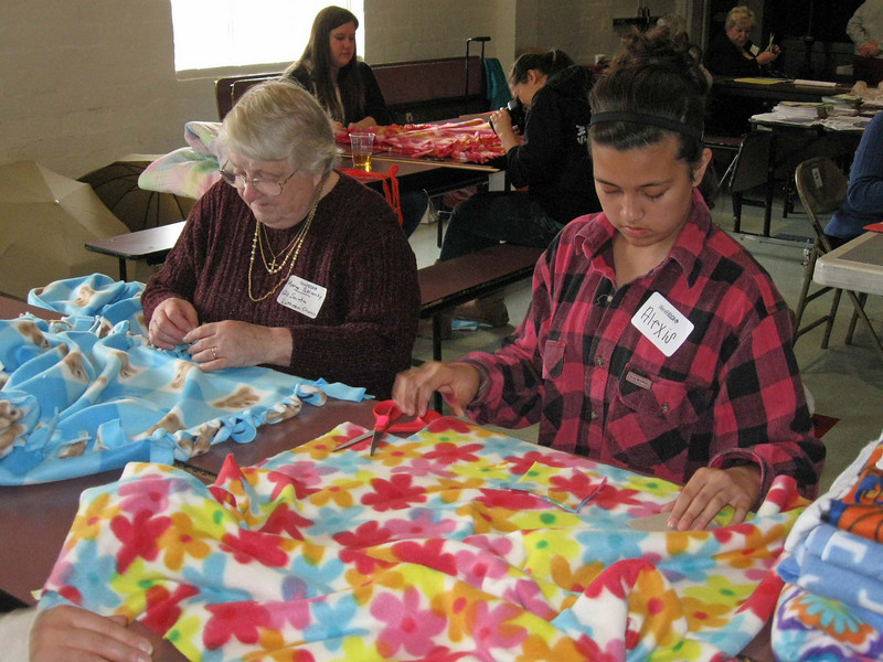 Marge Sklarsky, All Saints Lutheran Church, Sun Valley, and Alexis Lammawin, Holy Trinity Lutheran Church, Thousand Oaks, cut and tie blankets.