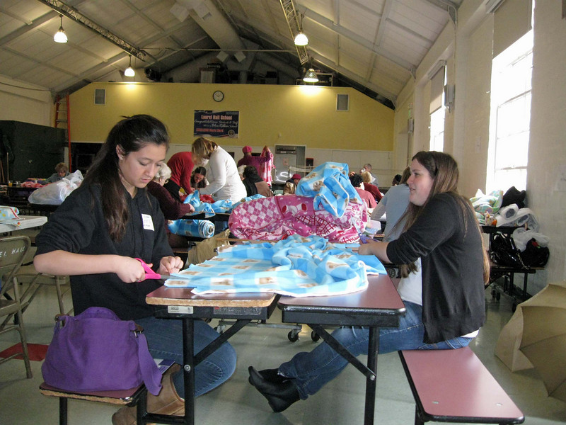 Emma Lammawin, left, a member of Holy Trinity, Thousand Oaks, and LYO president, and Courtney Bassler, Emmanuel Lutheran, North Hollywood, synod council youth representative and LYO board member, work on blankets.