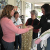 Belinda Simonini, l-r, shows Doris Anderson, Molly Hall, and Laure Reynolds how she made a pair of adult pajama pants. In 2009, the pajama project of Bethlehem Lutheran Church, Encinitas, Calif., provided more than 1,200 pairs of pajamas to 13 charities in San Diego county and Tijuana, Mexico. The group is talking about branching out to adult pajamas. Photos by Terri Lackey