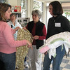 Belinda Simonini, l-r, shows Molly Hall and Laure Reynolds how she made a pair of adult pajama pants. (Doris Anderson, who made 130 sets last year is in the background.)  In 2009, the pajama project of Bethlehem Lutheran Church, Encinitas, Calif., provided more than 1,200 pairs of pajamas to 13 charities in San Diego county and Tijuana, Mexico. The group is talking about branching out to adult pajamas. Photos by Terri Lackey