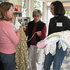 Belinda Simonini, l-r, shows Molly Hall and Laure Reynolds how she made a pair of adult pajama pants.  In 2009, the pajama project of Bethlehem Lutheran Church, Encinitas, Calif., provided more than 1,200 pairs of pajamas to 13 charities in San Diego county and Tijuana, Mexico. The group is talking about branching out to adult pajamas. Photos by Terri Lackey