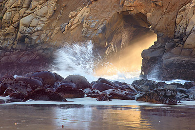 Ocean waves, mist and light streamed through the portal in the Tafoni sandstone on a clear and warm January evening. Every once in a while, it would almost appear as though the light were striking the water, sending spray away from the impact point.  I chose to step back to include some reflected light off the sand at low tide to add an added element of interest.